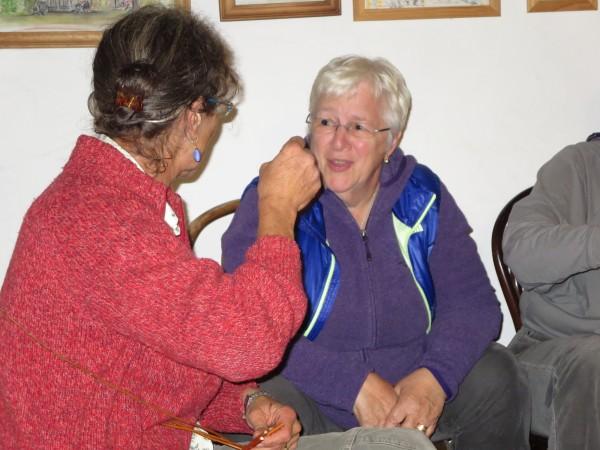 Malo helps Myrna make her basket