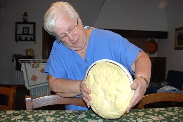 Myrna begins the kneading process